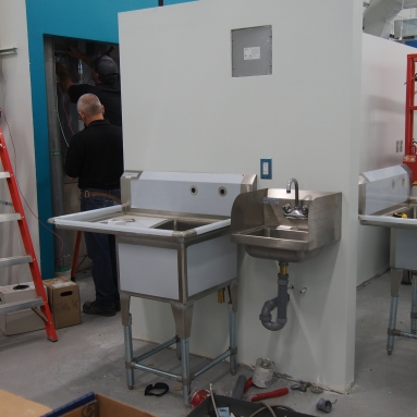 a prep sink and handwashing sink installed on the wall