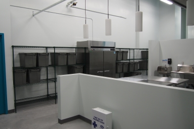 wire shelf system with grey plastic boxes