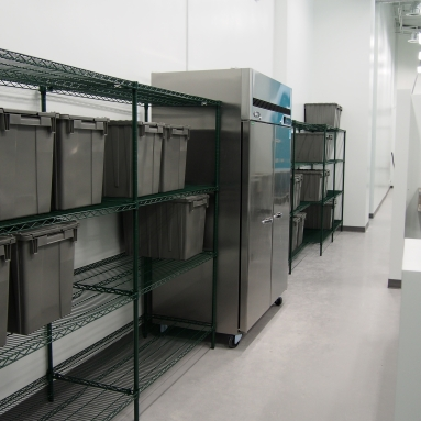 hallway with wire shelving and freezers