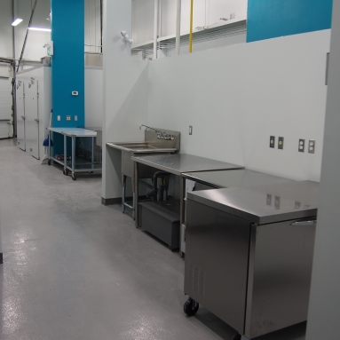 commercial kitchen prep space with stainless steel tables
