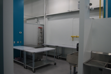 commercial kitchen prep space with stainless steel tables.