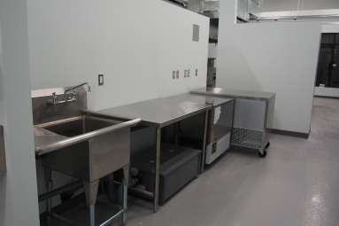 commercial kitchen with stainless steel tables and a fast freezer machine