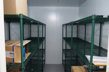jade wire shelving laid inside the interior of a walk-in cooler