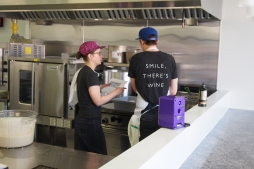 staff in front of deep fryer
