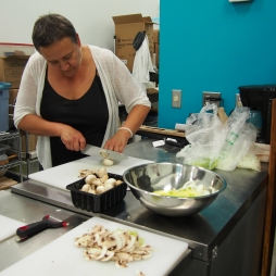 Cauldron Food School student slicing mushrooms.
