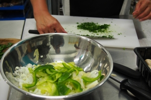 Finely chopping the parsley at the Cauldron Food School.
