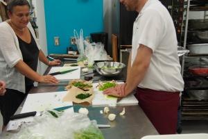 Pressing garlic at The Cauldron Food School.