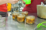 Pouring the plum chutney into jars.