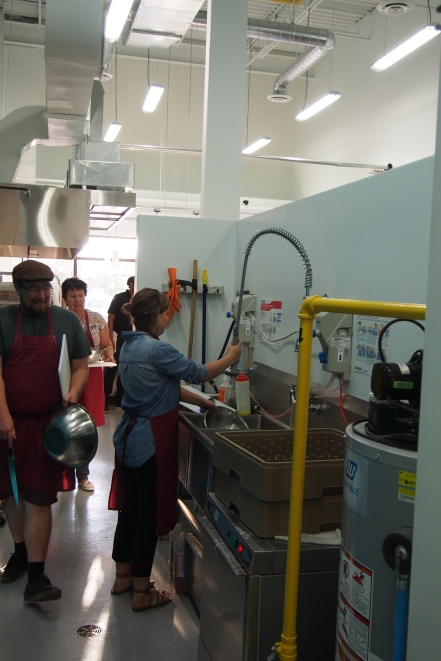 Students cleaning the equipment.
