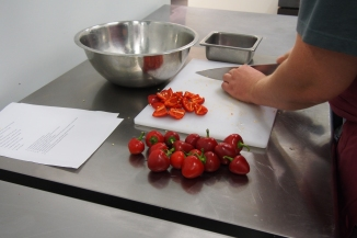Chopping red peppers for the antipasto.